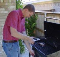 DJ grilling steak for dinner